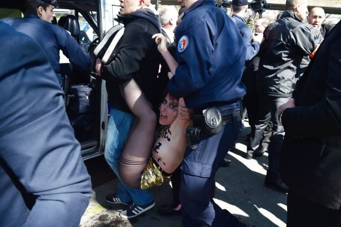 TOPSHOT-FRANCE-POLITICS-LABOUR-DEMO-MAY1-FN-FEMEN